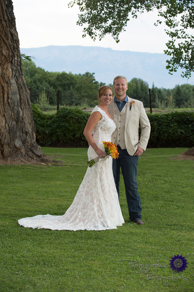 tan sports jacket, lace wedding dress, call lilies, outdoor phot