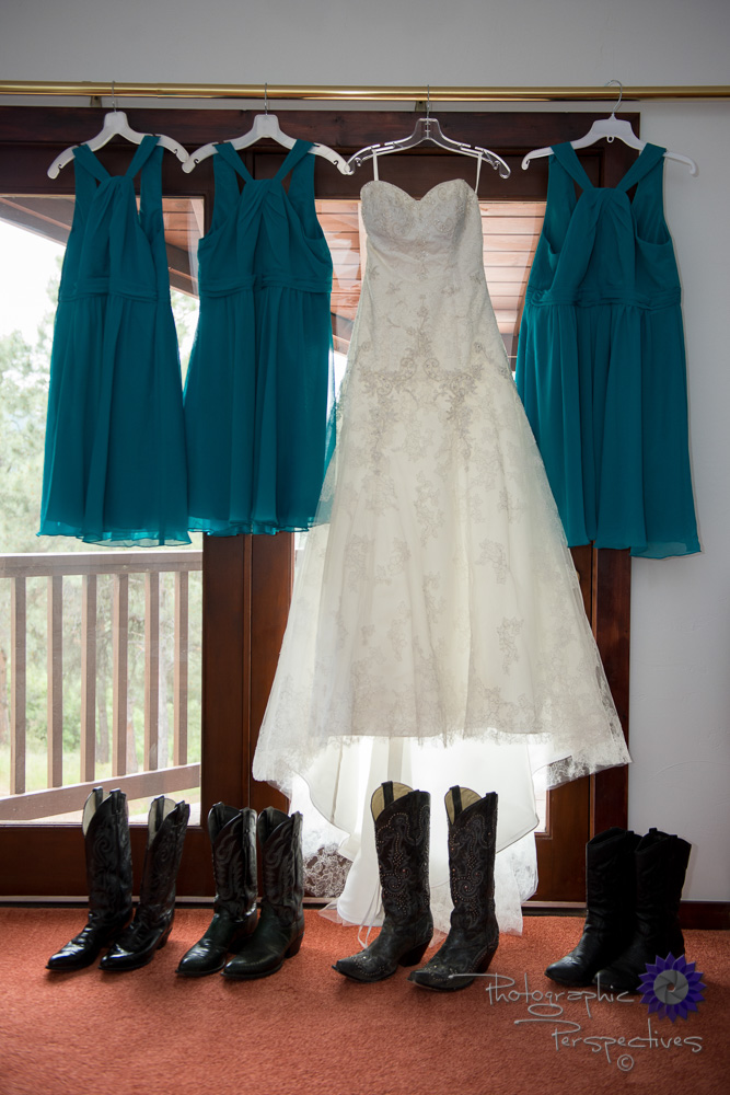 Wedding dress, teal bridesmaid dresses, cowboy boots, hanging we