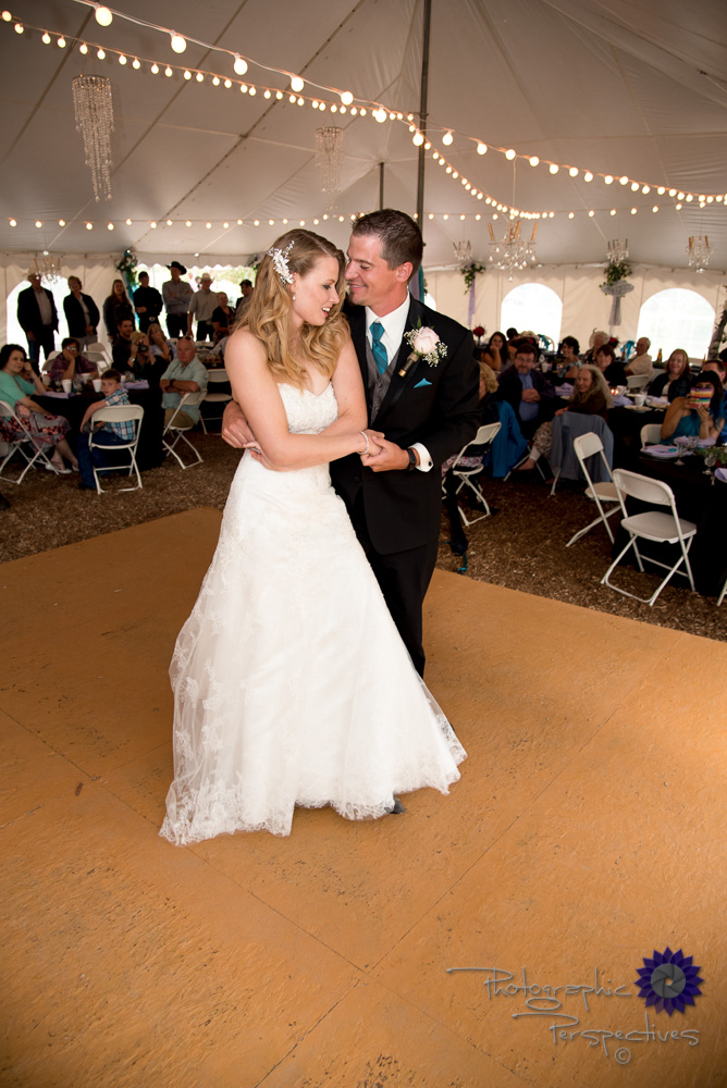 first dance, wedding reception, bride and groom, center of atten