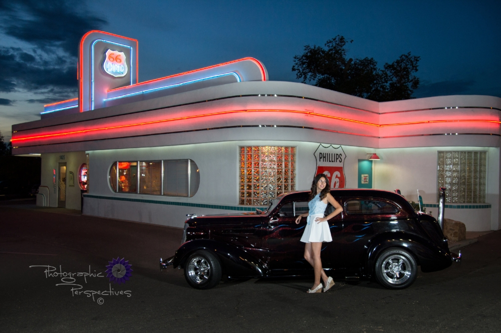 Gabriella Tafoya senior photo at Route 66 Diner from Albuquerque photographers Photographic Perspectives in front of diner with Classic Car 1937 Chevy