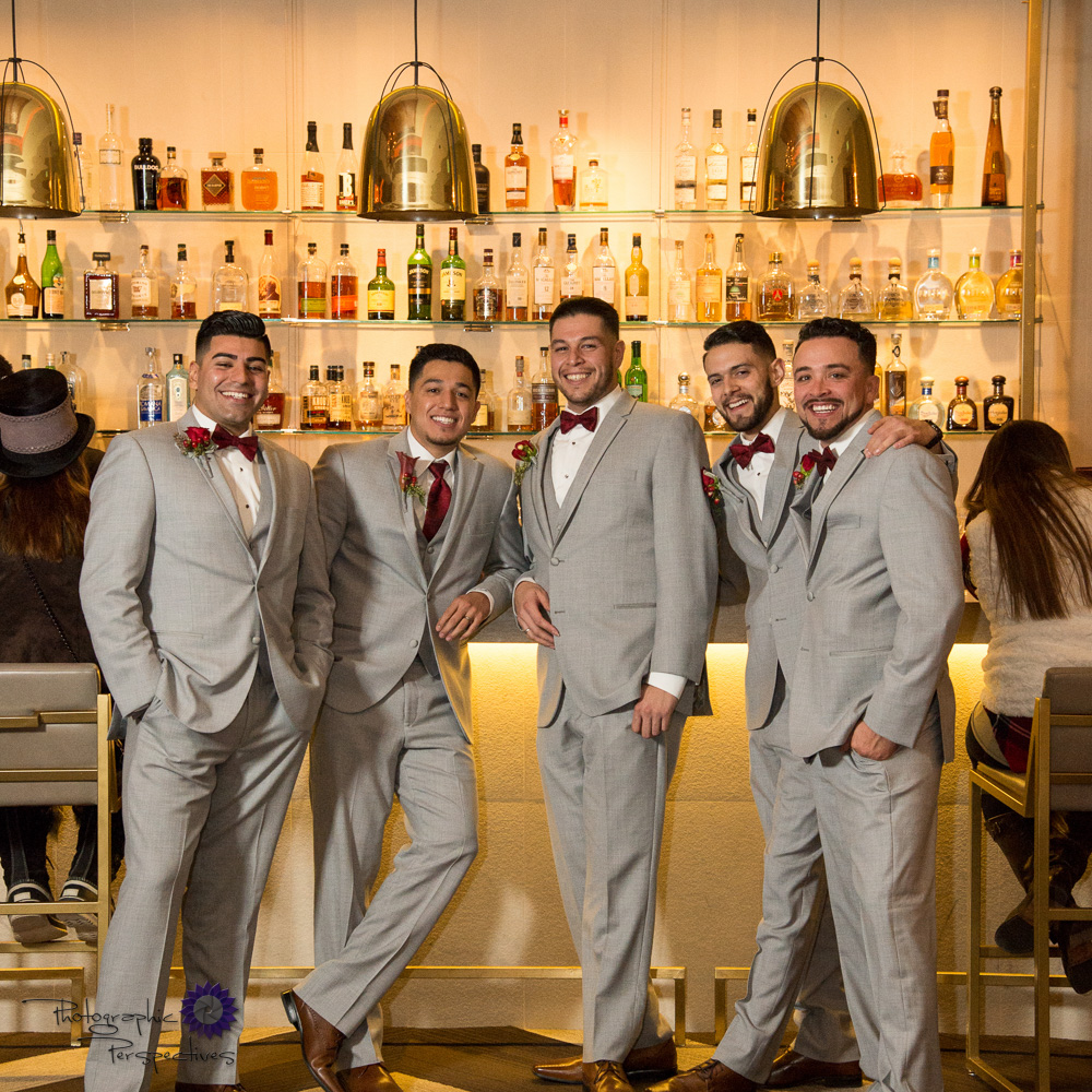 Eli and his groomsmen getting a cocktail before the ceremony starts.