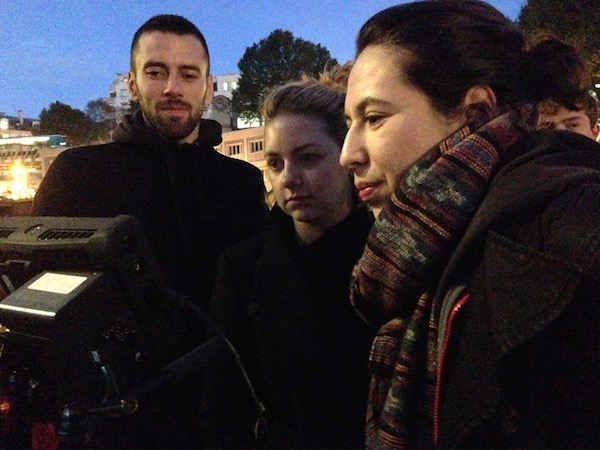 Bruno Guillard, Hannah L. Smith, and Selen P. Flores review footage on set of Margot in Paris, France. Image by:Photo cred:Valentin Wattelet