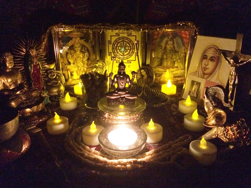 Center:  Shiva on coiled Kundalini dais, Left to right:  Meditation Buddha, Mata Maria de Guadelupe, Laughing Buddha of Abundance, Shakti Ma (Sri Lalita), Sri Yantra, Shiva , Vallalar Ramalinga Swamigal with Mother Mirra and Sri Aurobindo, Sri Jesus on cross, Elephant Ganesh