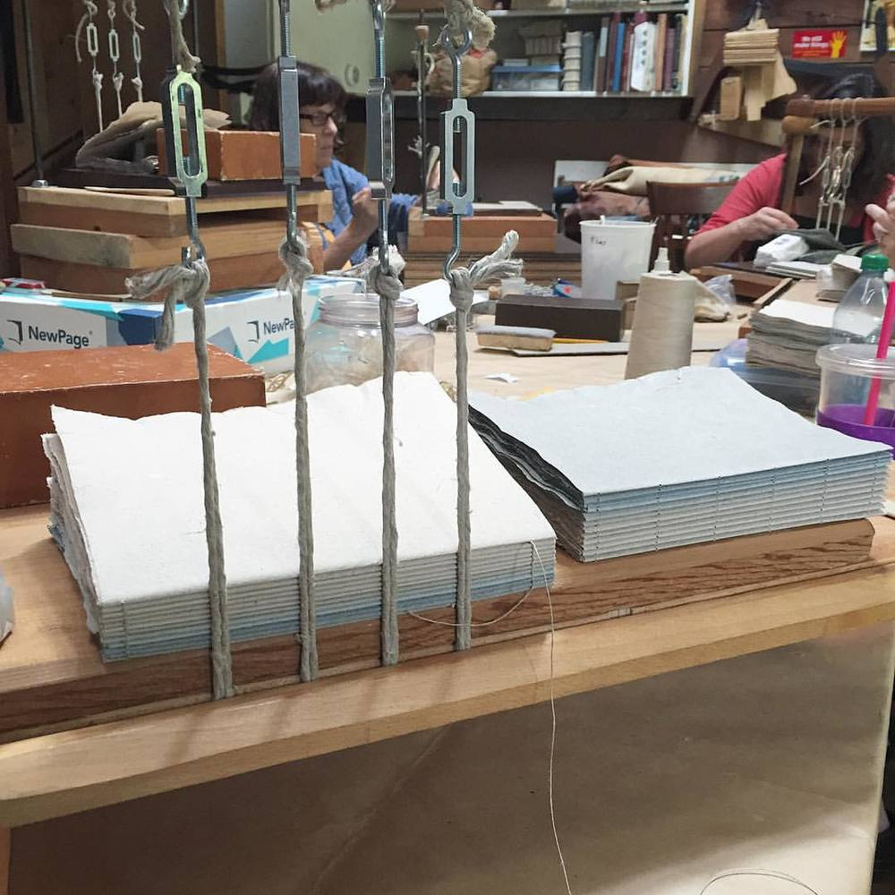 Tbt: Jim Croft Traditional Bookbinding Workshop day 6: sewing day! This was the first time using a sewing frame made sense. We sewed our signatures on to double raised cords and Jim laughed as we all tediously prepared punching jigs and pre-punched our signatures (he said he always just punched the holes as he goes 😱 but I think that's pretty typical for experienced book binders.) It felt good to finally see something that looked like a book forming.