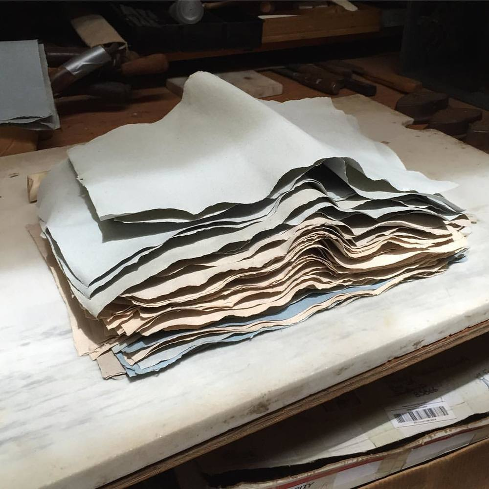 TBT: Jim Croft Bookmaking the Old Way workshop day 6 – after the Spurs of paper were dry, we separated the sheets and distributed them. This is my pile of handmade paper before it was burnished and folded into signatures for the book.