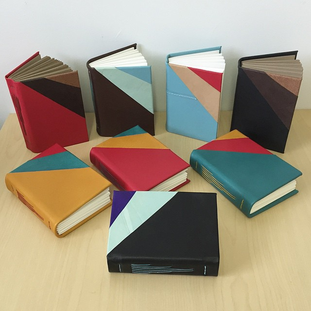 "A sample batch of the geometric 3.5"" x 5"" hard cover journals. All of the books in the back row and the one in the front are made with 100% reclaimed leather and all of the books use 100% of recycled paper and book board. These guys will be selling for $40 each and I'll be preselling here on insta so let me know if you want one.  (at Is Projects)"