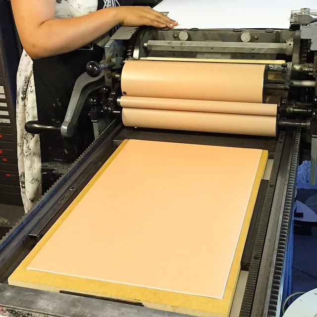 @notnathalie is printing apricot flats with the new linoleum base for the Vandercook. It's been a while since the Vandy has been anything but black so this change is extra nice 🍑🍑🍑🍑 (at Is Projects)