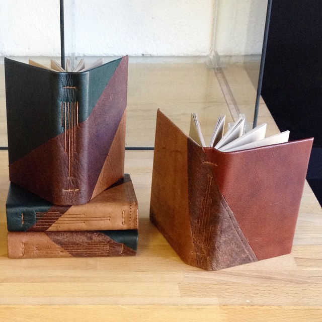 New geometric leather hardcover journals using recycled and reclaimed materials. From now on all paper at ISP and Nocturnal Press will be either 100% PCW recycled or 100% cotton (fibers reclaimed from the fabric industry) (at Is Projects)