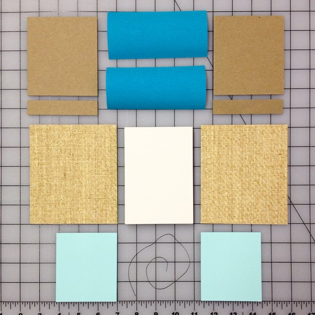 Parts of a book: book boards, cover paper, end paper, book cloth, text block, and linen thread (pva glue not pictured) All of this will soon become a hard-cover Japanese stab binding. Stay tuned! (at Is Projects)