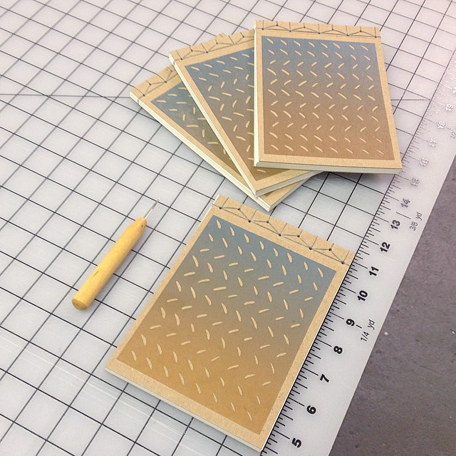 Japanese Stab journals using the traditional Hemp-Leaf Binding. Not so traditional letterpress printed linocut cover with gold-blue blend roll. (at Is Projects)