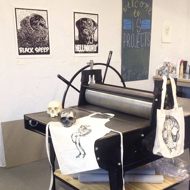 ISP is staying spooky for the Dia de Los Muertos open house tonight from 6-10 pm. Come by and see Jess Condon's show, Monstrosity, and get a super sweet custom printed tee, apron or tote bag.