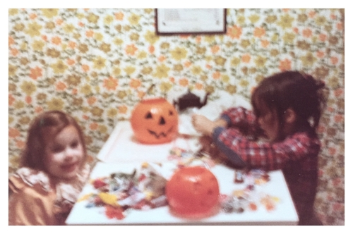 this photo may be blurry, but look who is seriously focused on the candy & who is cheesing for the camera. the halloween fanatic has her priorities straight. my little sis does look adorable though.