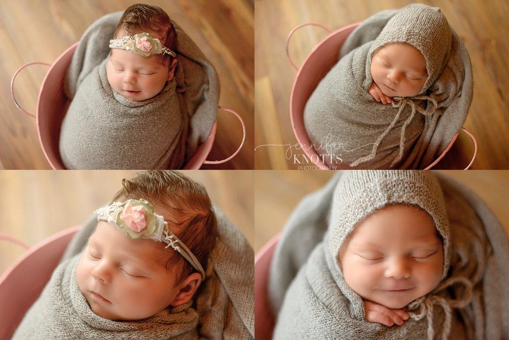 baby girl wearing gray bonnet in pink bucket