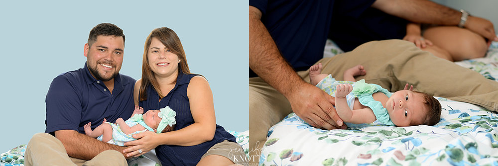 parents hold newborn baby on blue and green bed