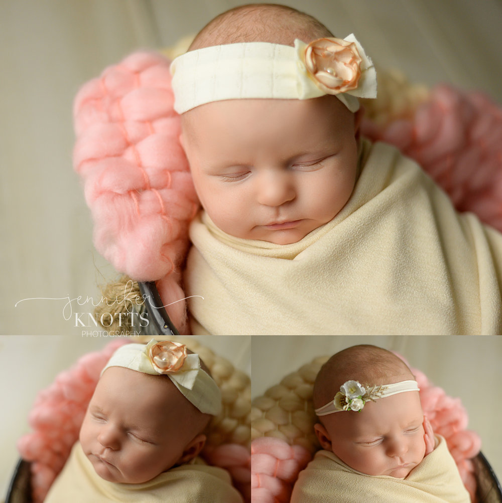newborn girl sleeps in a bucket surrounded by neutrals and pink
