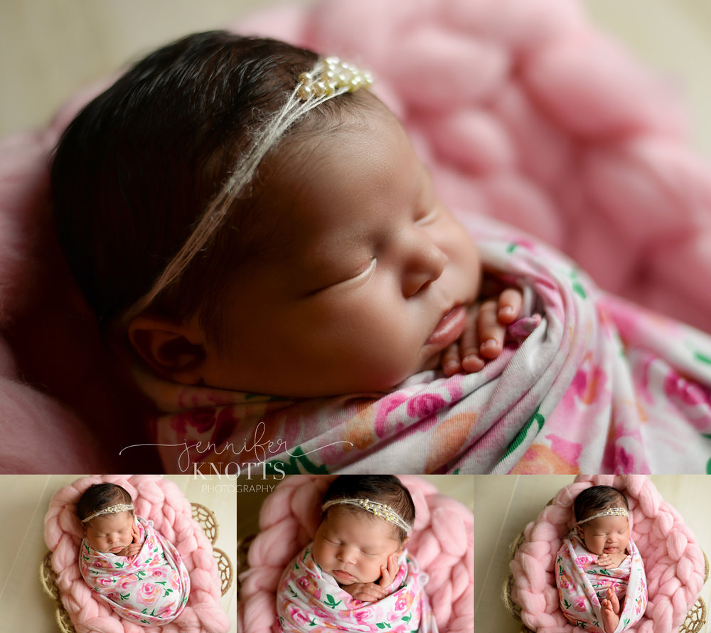 baby girl wrapped in floral fabric sleeps on pink fluff in basket during Wilmington nc newborn session