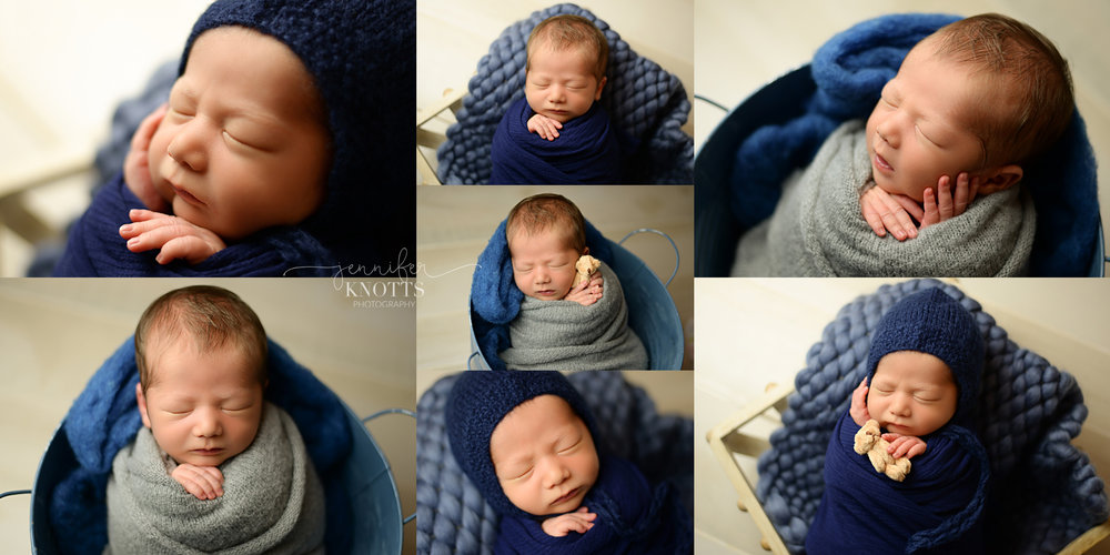 swaddled newborn boy sleeps in blue bucket during Wilmington photography session