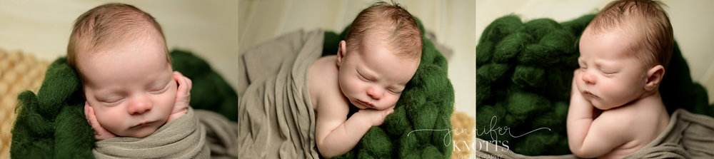 newborn boy on green fluff swaddled in tan fabric during Wilmington photography session