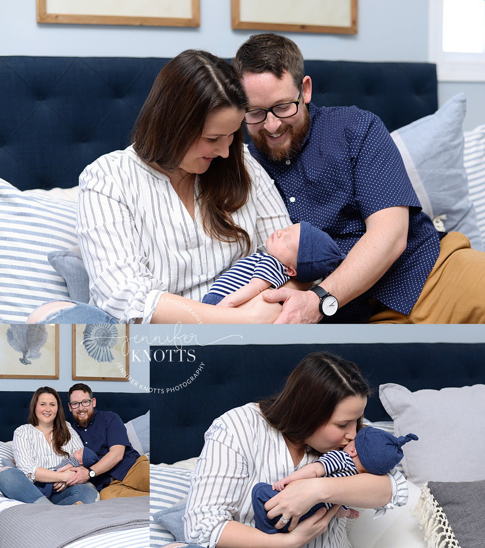 parents hold newborn baby boy on bed during Wilmington nc newborn session