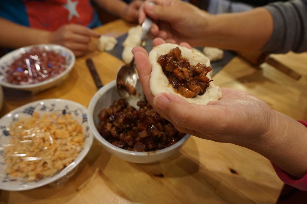 Cooking with bao with Kim and her mom