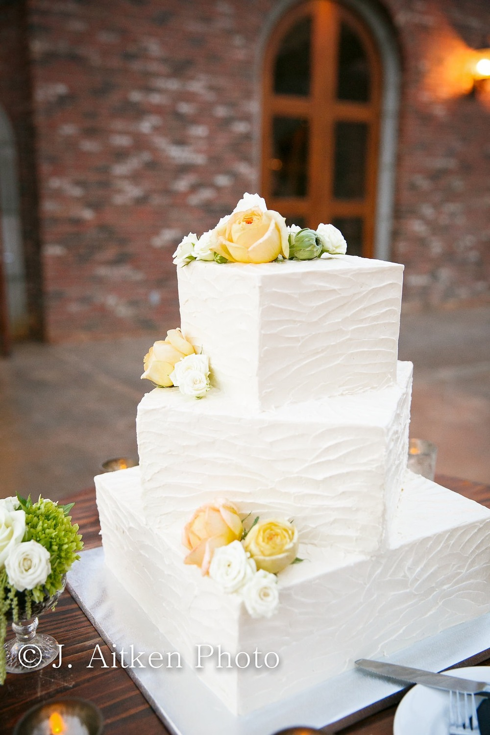 Wedding Cake with Square Offset Tiers and Rustic Buttercream
