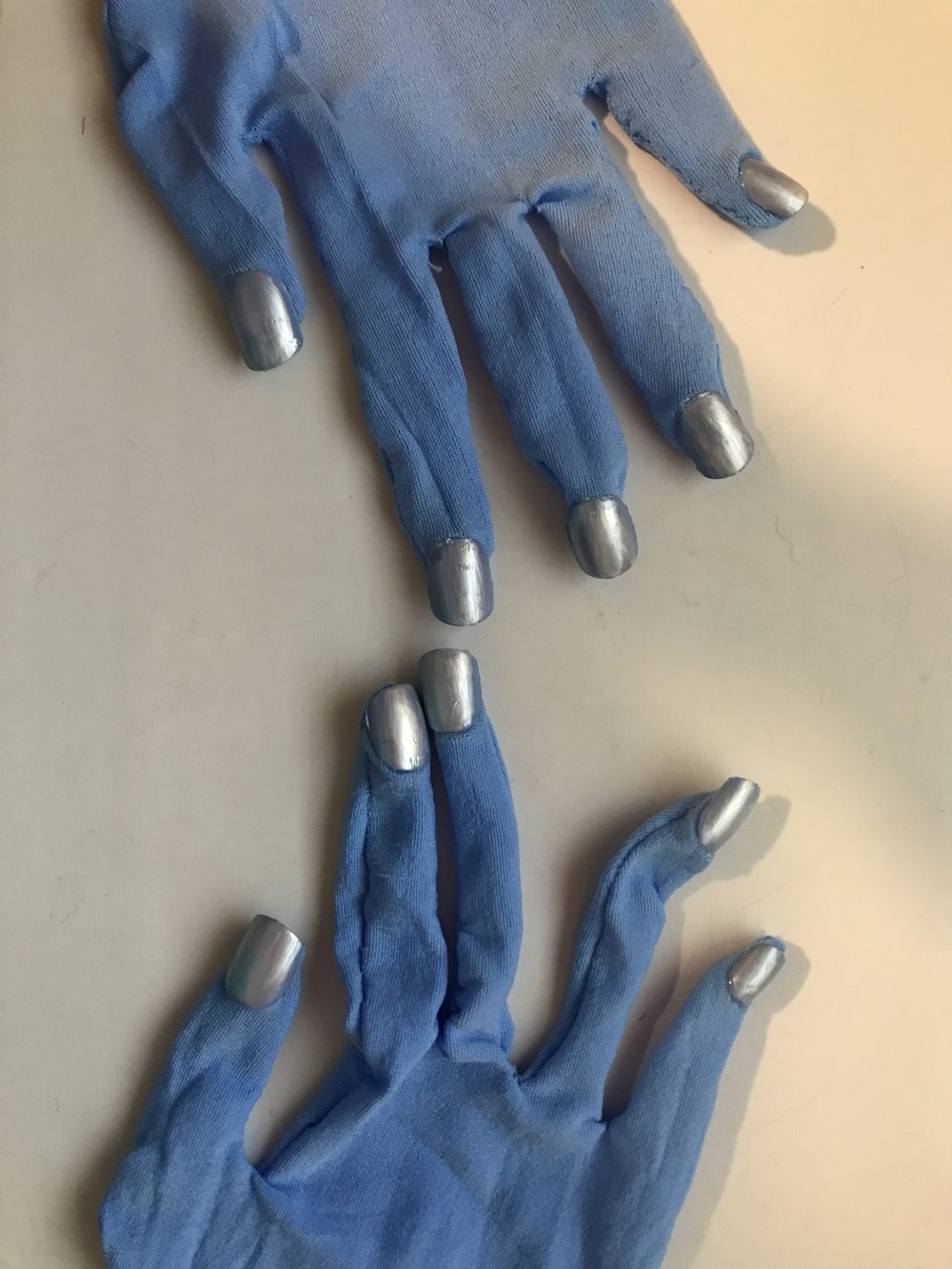 I painted some fake nails and glued them onto the gloves to make it more realistic.