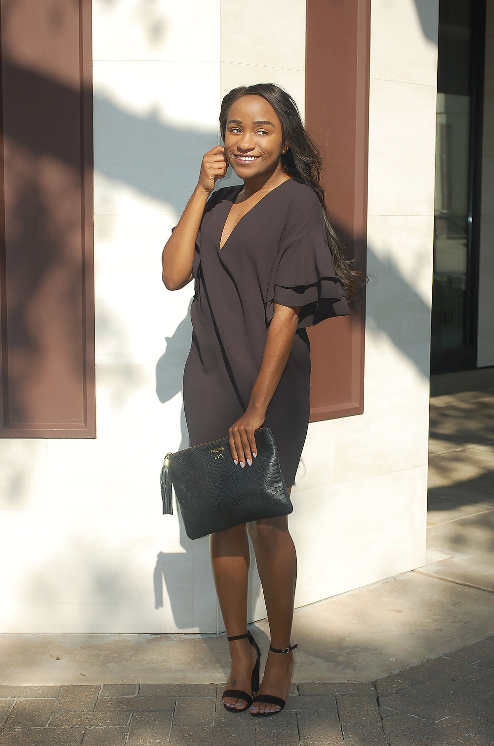 THE DEETS:  Frilled-Sleeve Dress -   ZARA  ; Black Uber Clutch -   GiGi New York  ; Lulu Block Heel -   Target