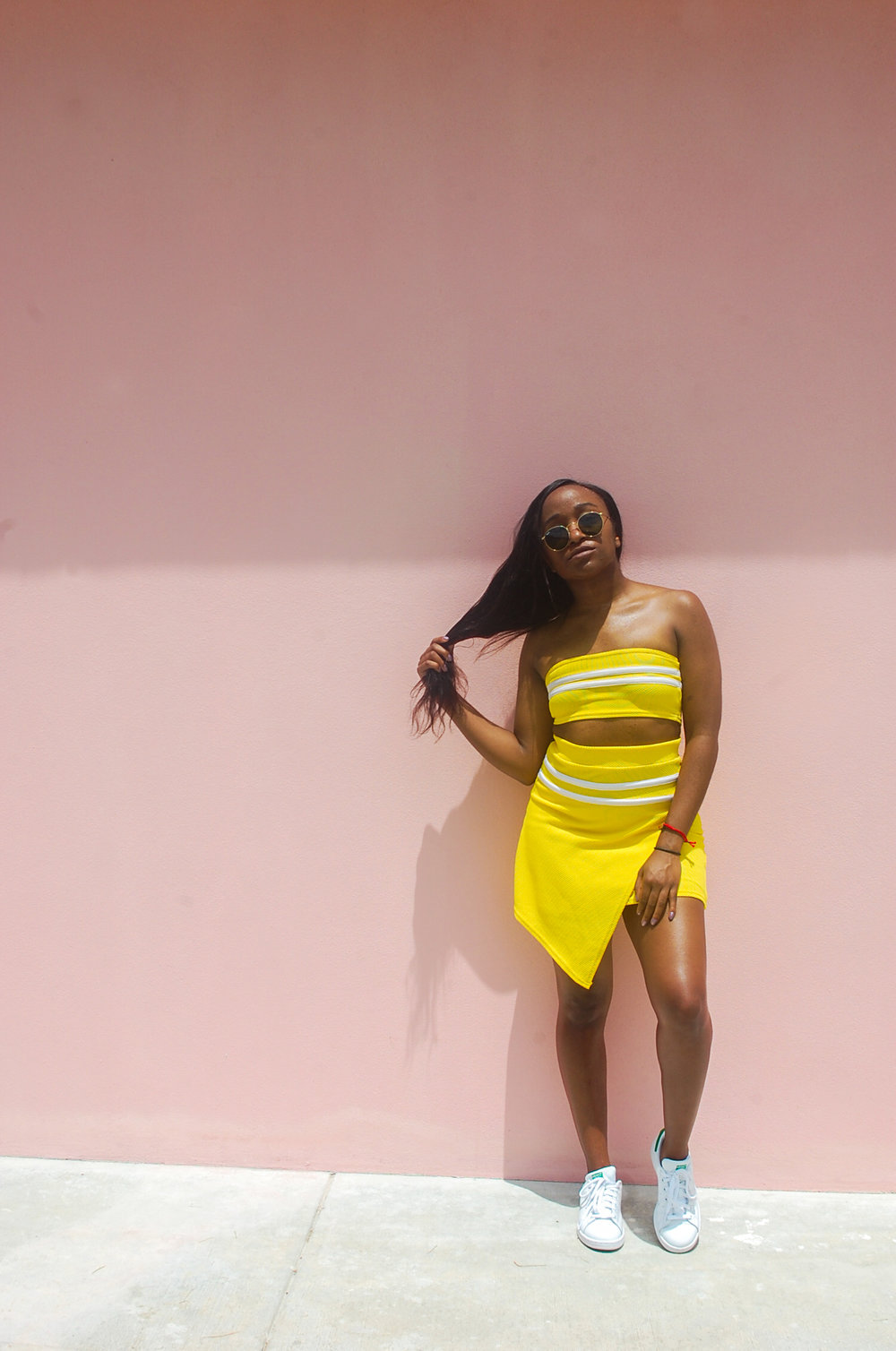 THE DEETS:  Zendaya Edit Sports Stripe Set -   Boohoo  ; Stan Smith Shoes -   adidas  ; Round Sunglasses -   RayBan
