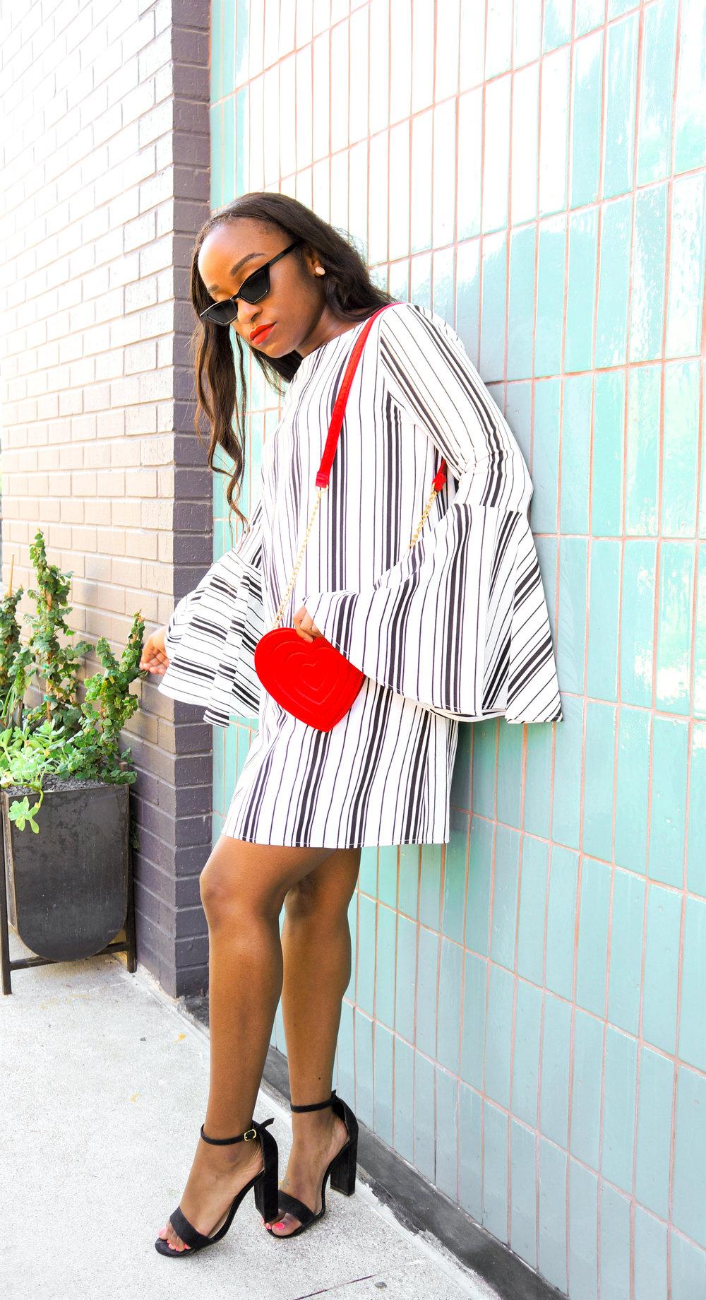 THE DEETS:  Low Key Low Cut Striped Day Dress -   AKIRA  ; Heart Bag -   Monki  ; Ema High Block Heel Pumps -   Target  ; Cat Eye Sunglasses -   Attention Frames