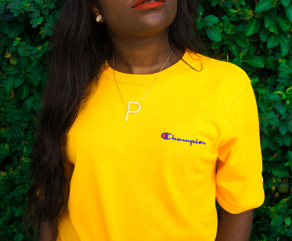 THE DEETS:  Champion Women's Chest Script Logo Heritage Tee -   AKIRA  ; Gold Initial Necklace -   6th Borough Boutique  ; Ellie Drusy Stud Earrings -   Kendra Scott
