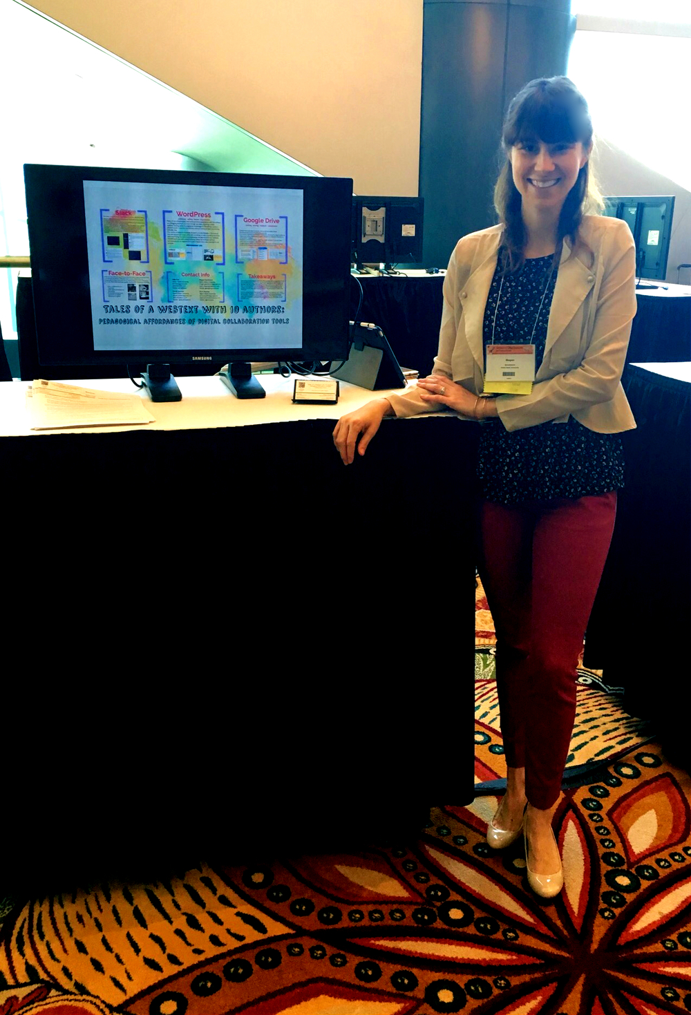 """Presenting a digital pedagogy poster, """"Tales of a Webtext with 10 authors: Pedagogical Affordances of Digital Collaboration Tools,"""" at the Conference on College Composition and Communication (CCCC's) in Houston, Texas, in April 2016. Photo Credit: Danah Hashem"""