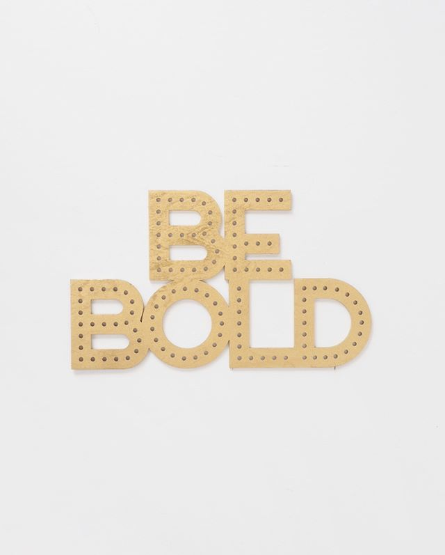 "Be BOLD or /italic/. Never regular ✌🏻💛 Am I right? Here's our ""Be Bold"" sign in gold. Swipe to see it in black!"