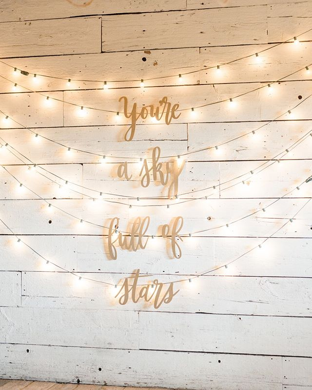 Definitely one of my favorites ever. I mean, what's dreamier than a huge hand lettered quote about stars surrounded by lights? #youreaskyfullofstars ⠀⠀⠀⠀⠀⠀⠀⠀⠀ Photo: @laurenfair | Planning/Design: @shannonwellingtonwedding | Venue: @terrain_events