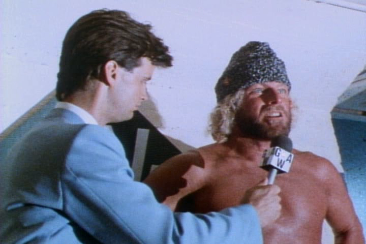 GRUNT! THE WRESTLING MOVIE HAS MANY CREATIVE NAMES FOR ITS WRESTLERS. INCLUDING 'THE COMMIE WARHEAD' (RIGHT) INTERVIEWED BEFORE HIS PARTICIPATION IN THE BATTLE ROYALE