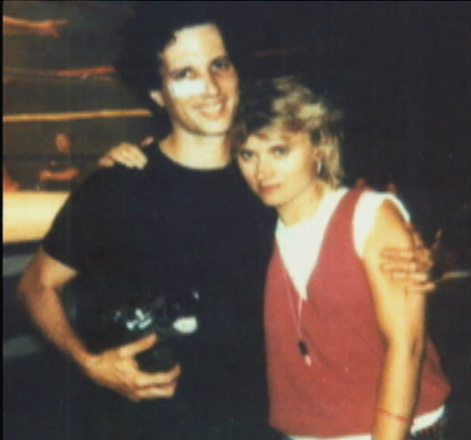 A BATTLE-SCARRED ALLAN HOLZMAN, HOLDING HIS TRUSTY 16MM BOLEX CAMERA, WITH WIFE SUSAN JUSTIN, WHO COMPOSED THE MUSIC FOR GRUNT! THE WRESTLING MOVIE.