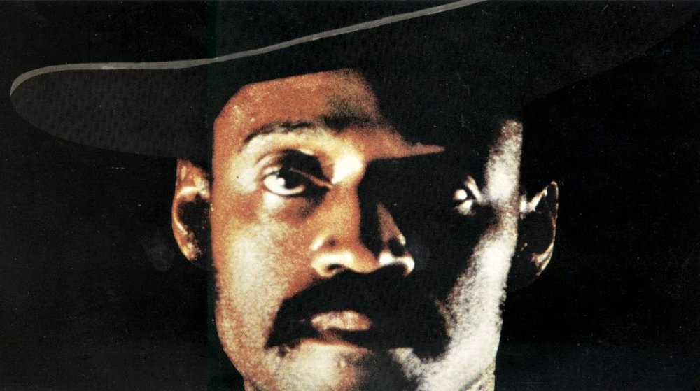 sweet-sweetbacks-baadasssss-song-1971-001-melvin-van-peebles-in-cowboy-hat-close-up-black-background_0.jpg