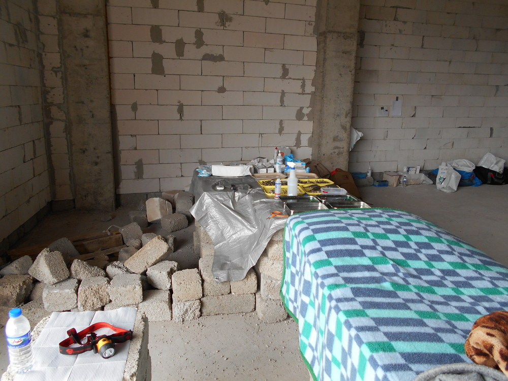 The dental team built their own clinic out of concrete blocks and construction leftovers in an abandoned parking garage-turned-refugee camp in Erbil, Kurdistan, Iraq
