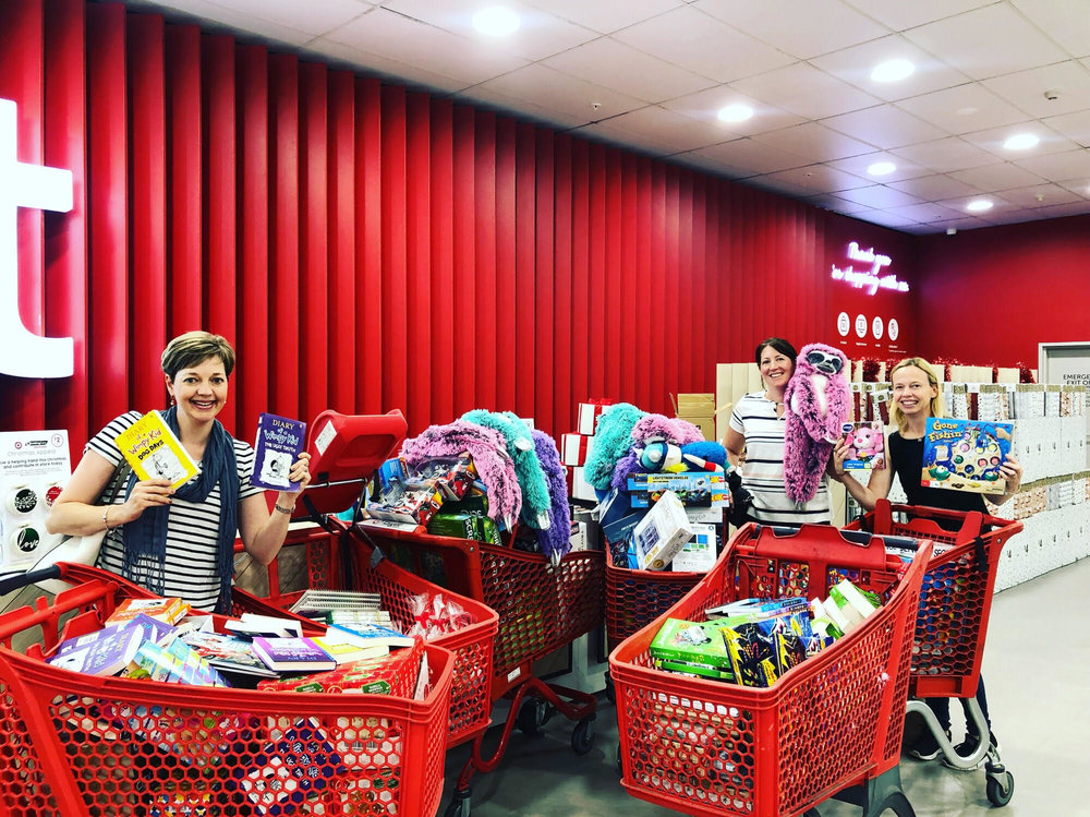 Spreading the Christmas spirit. - So here we are at the tills at Target in Chatswood with our 6 trolleys full of toys for the kids in hospital. We have had a ball shopping! Thank you so much for all the donations via our online shop.This is what YOU have helped us achieve!
