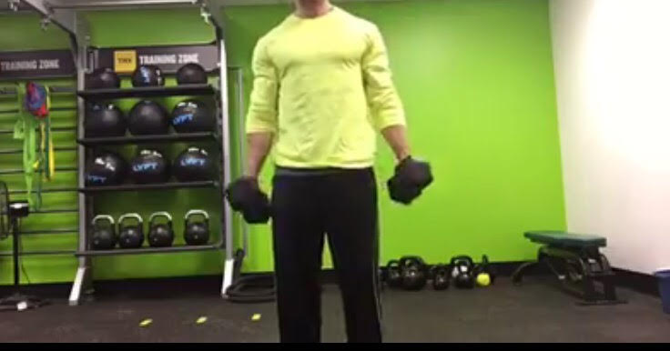 This will be your starting position. Standing with dumbbells down by your side.