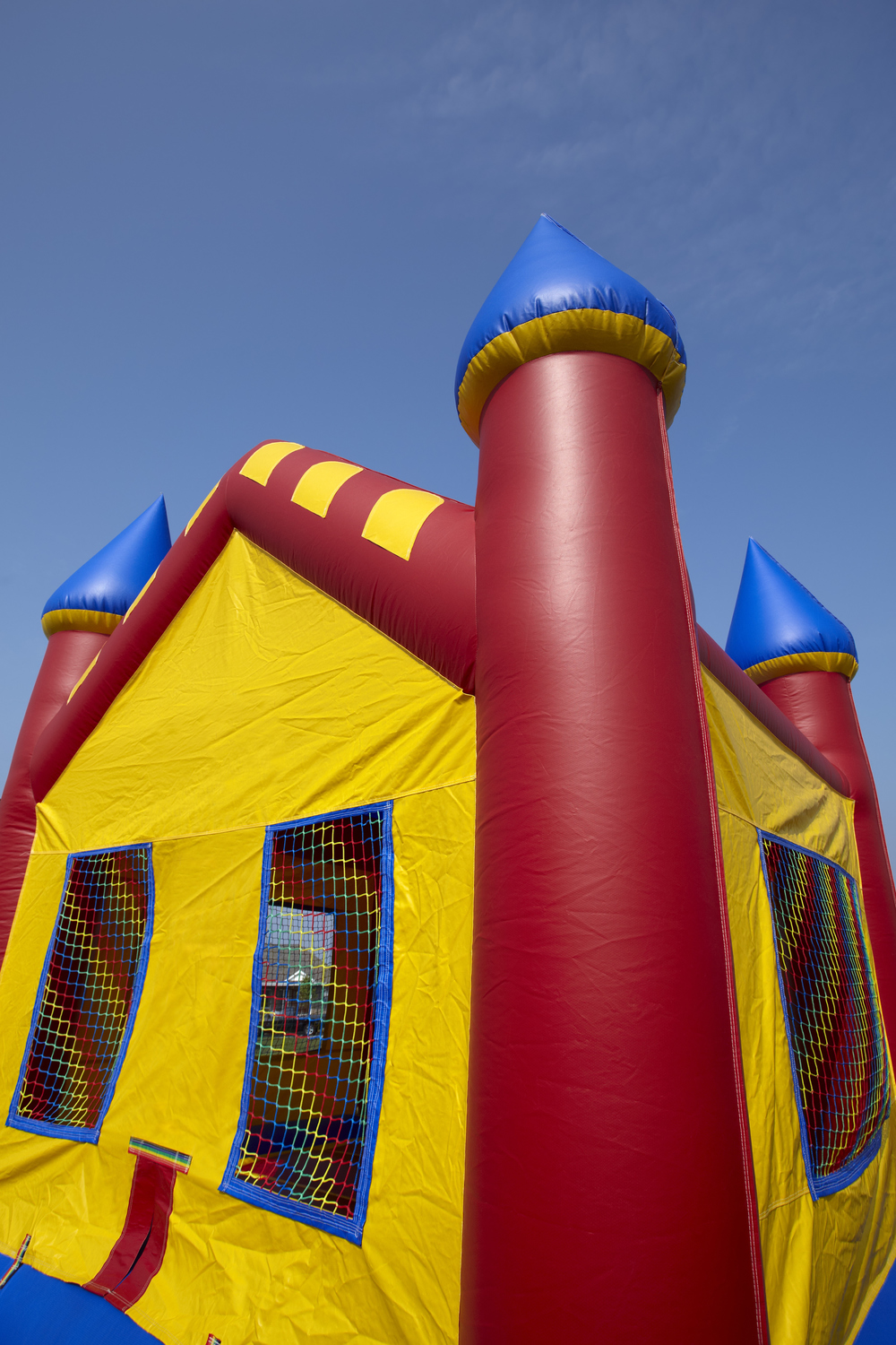 Red yellow and blue moonbounce castle rental.