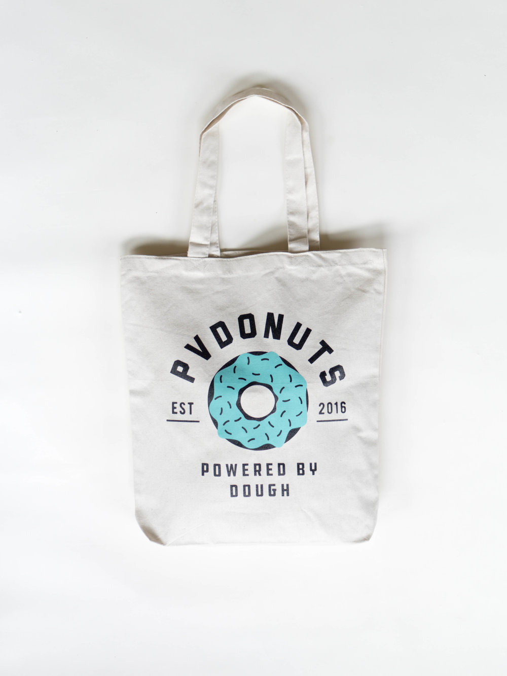 Powered by Dough Tote Bag - $12    Sizing may vary; print will not