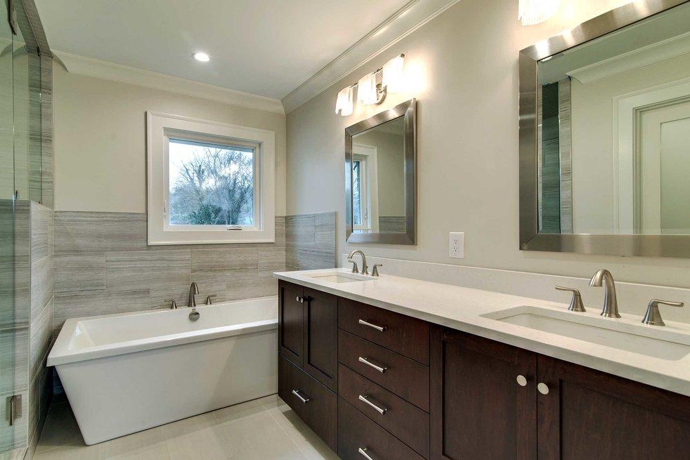 gray_tile_walnut_cabinet_soaking_tub_bathroom.jpg