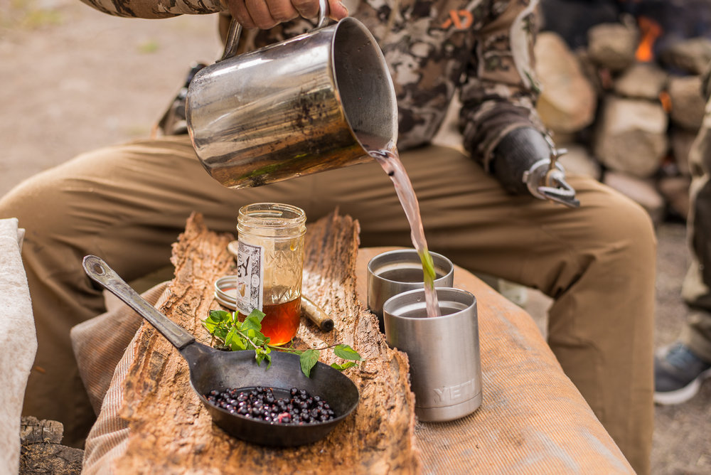 making a wild foraged blackcurrant and moonshine hot toddy at 10,000ft in the montana mountains.  PHOTO: YOGESH SIMPSON