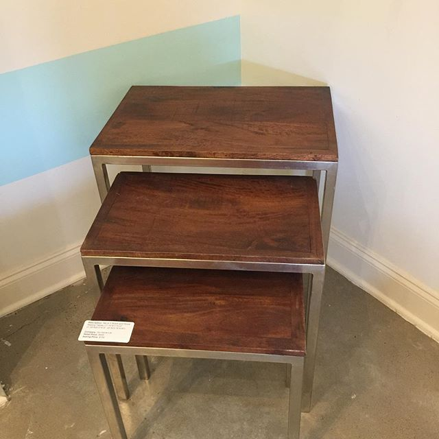 In addition to 50% off all apparel & accessories and 30% off all bikes, we have some great pieces for your home. Like this set of 3 nickel and wood nesting tables!