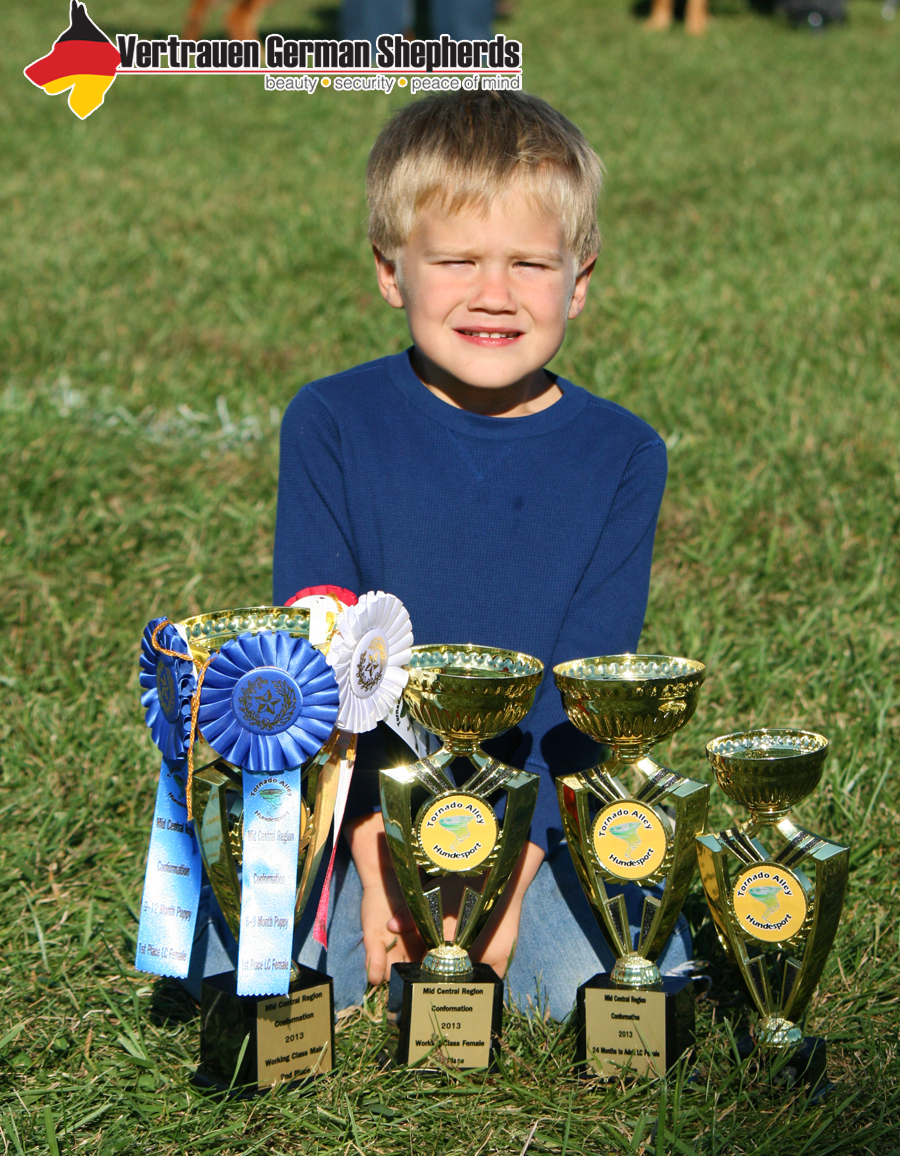 Cade and trophies.jpg
