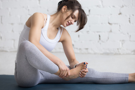 52935337_S_foot_pain_arch_woman_exercising.jpg