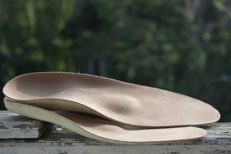 81203080_S_custom_orthotic_pair_beige.jpg