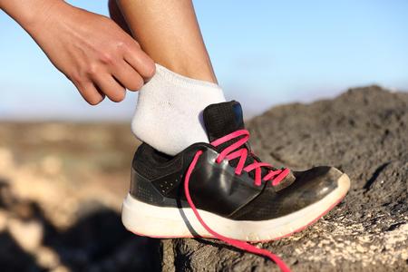 55645917_S_hiker_socks_changing_sneaker_runner_mountain_outside_jogger.jpg