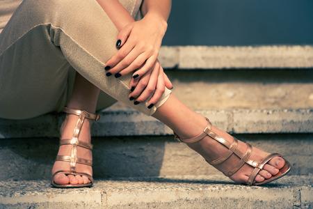 39504360_S_woman_steps_heels_sandals_sitting.jpg
