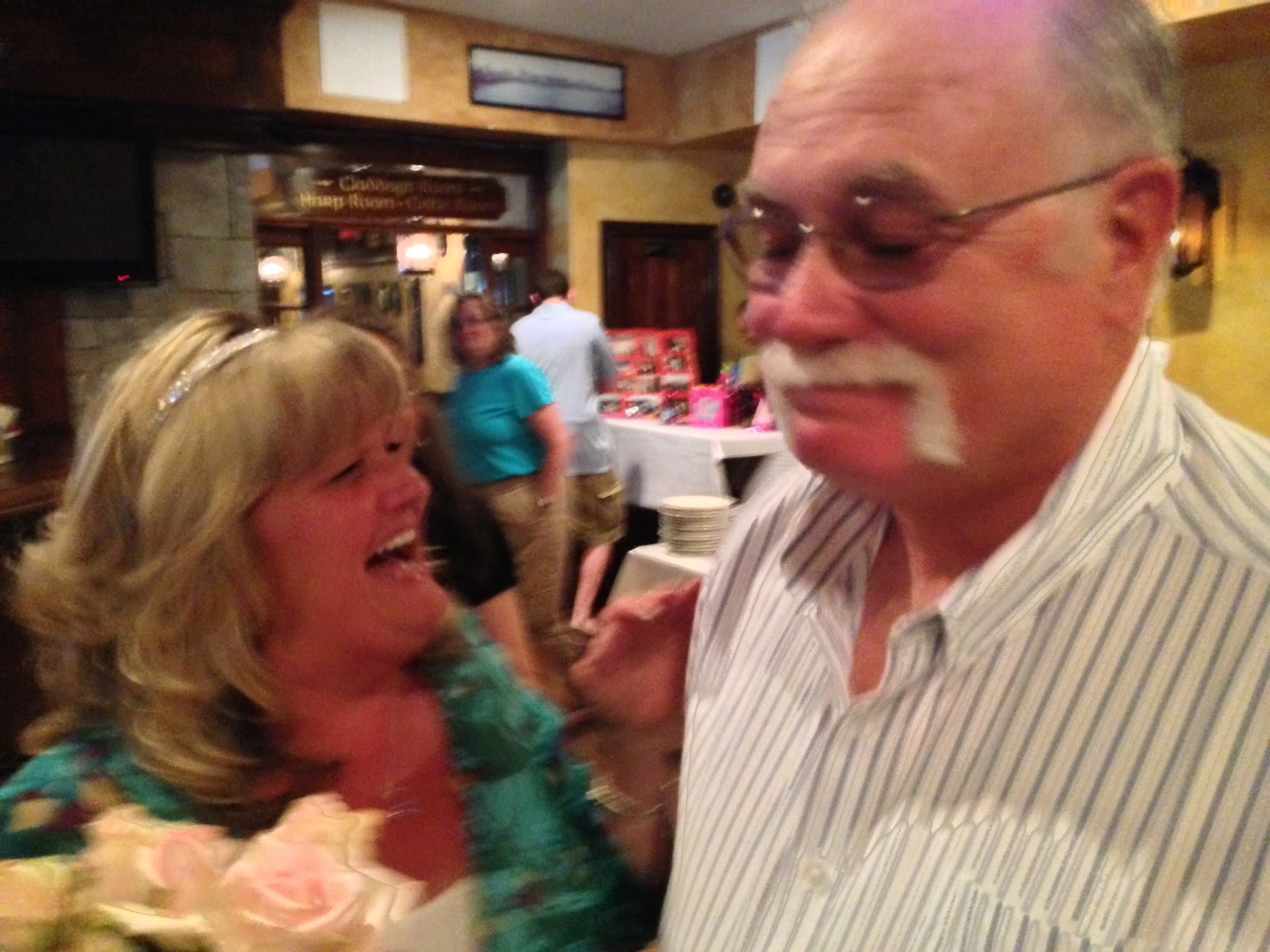 "Not the best photo, but one of my favorites from when my mom told my dad she couldn't believe he didn't ""screw it up"" after he surprised her with a 60th birthday party."